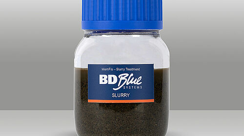 Small bottle with untreated slurry
