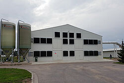 Poultry house and two silos
