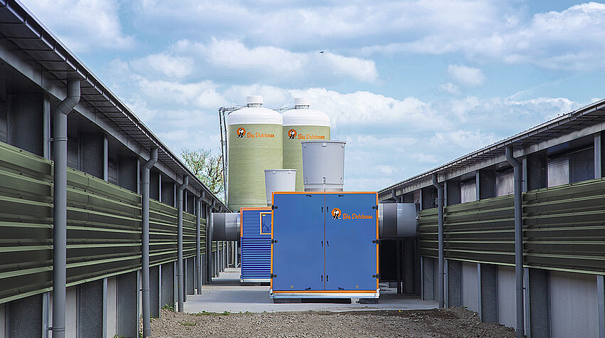 Heat exchanger between two broiler production houses