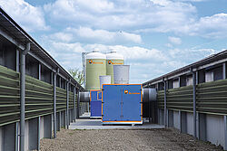 Heat exchanger between two broiler houses