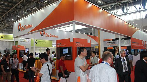 Large crowds gather at the Big Dutchman booth at the 2016 VIV show Beijing