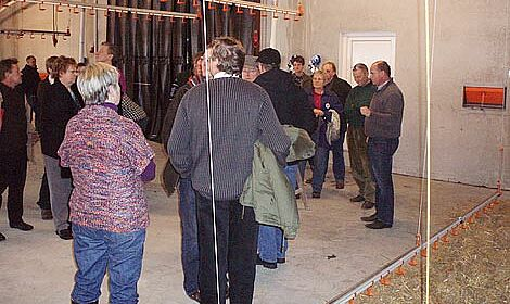 Host Ulrich Löhr leads a group of visitors on a tour through the new shed