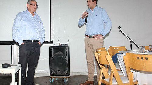 Big Dutchman sales manager Martin Prang (right) addresses Yona Glicksman.