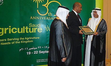 Saudi Arabia: The agricultural minister (right) and Prince Saud Bin Abdallah Al Faisal hand over the anniversary award to Khalid Abdelrahman.