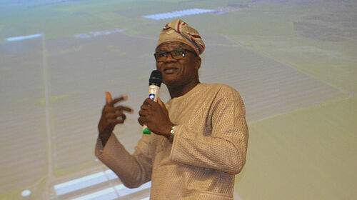 Professor Adesehinwa with microphone